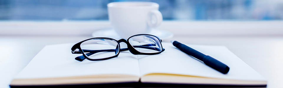 Eyeglasses on Notebook. Management Letter Fix-it Guide: Expenses.