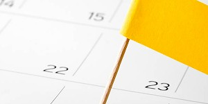 403(b) Plan Document Deadline Approaches. Yellow Flag on Calendar.
